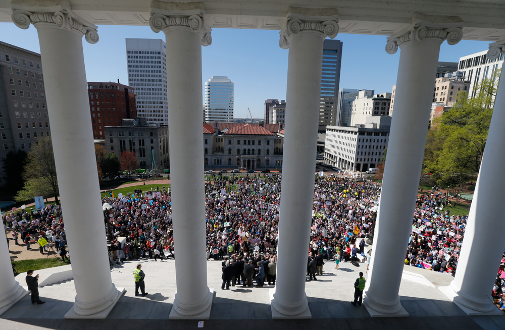 FILE - In this April 3, 2019, file photo, Right to Life marchers gather on the steps of the Capitol to listen to speakers in Richmond, Va. As abortion opponents cheer the passage of fetal heartbeat laws and other restrictions on the procedure, abortion-rights groups have been waging a quieter battle in courthouses around the country to overturn limits on providers. The first case to make it to trial is a lawsuit challenging abortion laws in Virginia. (AP Photo/Steve Helber, File)