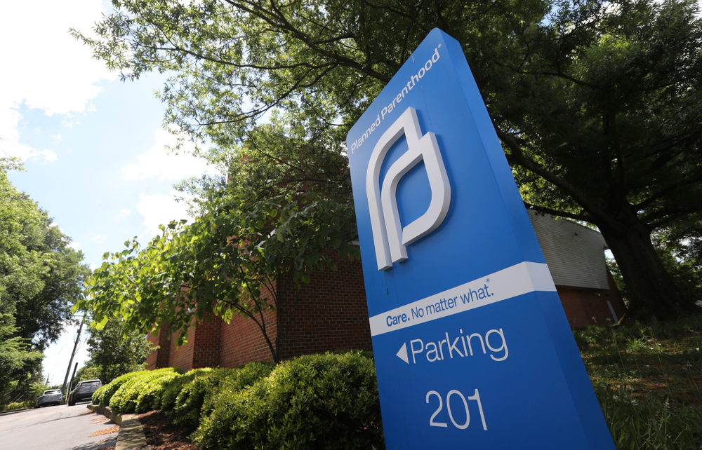 FILE - This May 15, 2019, file photo shows a sign in front of the Planned Parenthood offices in Richmond, Va. At least a dozen lawsuits have been filed over the last two years challenging what abortion-rights groups call targeted restrictions on abortion providers. Planned Parenthood is challenging physician-only laws in Virginia, Maine, Wisconsin, Idaho and Arizona. (AP Photo/Steve Helber, File)