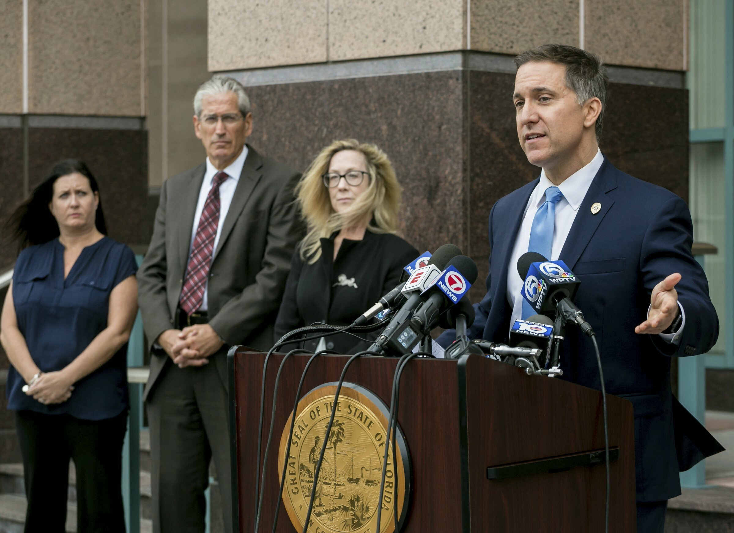Palm Beach County State Attorney Dave Aronberg speaks to the media with assistants, from left to right, Judy Arco, Al Johnson, and Elizabeth Neto, about charges in recent prostitution investigations outside his offices Monday, Feb. 25, 2019 in West Palm Beach, Fla. New England Patriots owner Robert Kraft visited a Florida massage parlor for sex acts the night before and the morning of last month's AFC Championship Game, which he attended in Kansas City, authorities said in documents charging him with two misdemeanor counts of soliciting prostitution. (Richard Graulich/Palm Beach Post via AP)