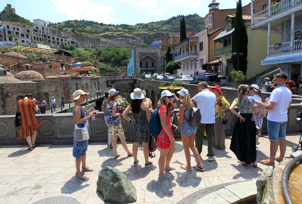 A soup of Russian tourists listen to a guide in The Old Town of Tbilisi, Russia, Saturday, June 22, 2019. Kremlin spokesman Dmitry Peskov noted that thousands of Russian tourists vacationing were in Georgia, as a reason of Moscow's concern about what he described as an anti-Russian