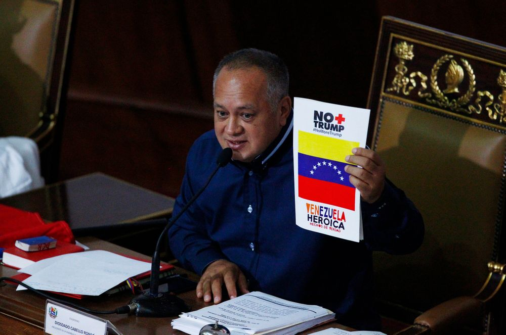 Venezuela's President of the National Constituent Assembly Diosdado Cabello holds up a sign that in Spanish says