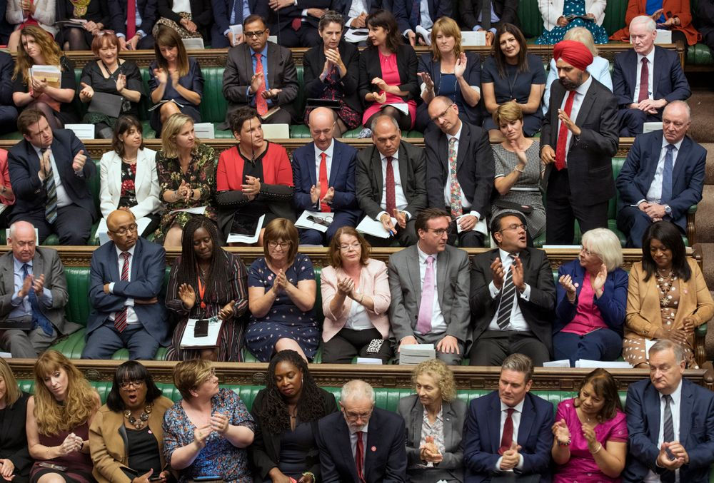In this handout photo provided by the House of Commons, Labour MP Tanmanjeet Singh Dhesi, standing, speaks during Boris Johnson's first Prime Minister's Questions, in the House of Commons in London, Wednesday, Sept. 4, 2019. A lawmaker for Britain's opposition Labour Party has gotten an unusual round of applause after challenging Prime Minister Boris Johnson to apologize for comparing Muslim women who wear face-covering veils to