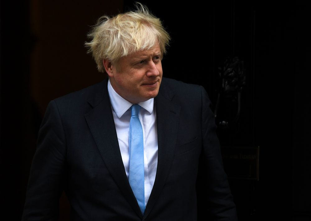 Britain's Prime Minister Boris Johnson walks out 10 Downing Street to greet the US Vice President Mike Pence, in London, Thursday, Sept. 5, 2019.(AP Photo/Alberto Pezzali)