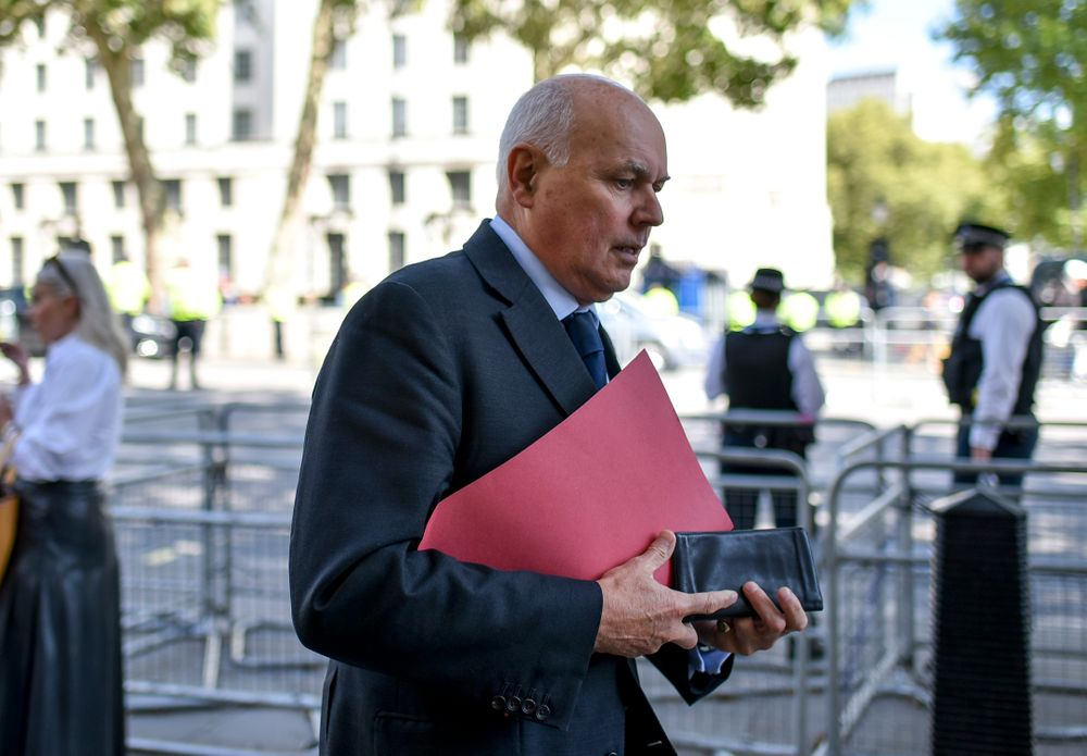 Conservative Party MP Iain Duncan Smith walks past the gates of Downing Street, in London, Thursday, Sept. 5, 2019. Prime Minister Boris Johnson kept up his push Thursday for an early general election as a way to break Britain's Brexit impasse, as lawmakers moved to stop the U.K. leaving the European Union next month without a divorce deal. (AP Photo/Alberto Pezzali)