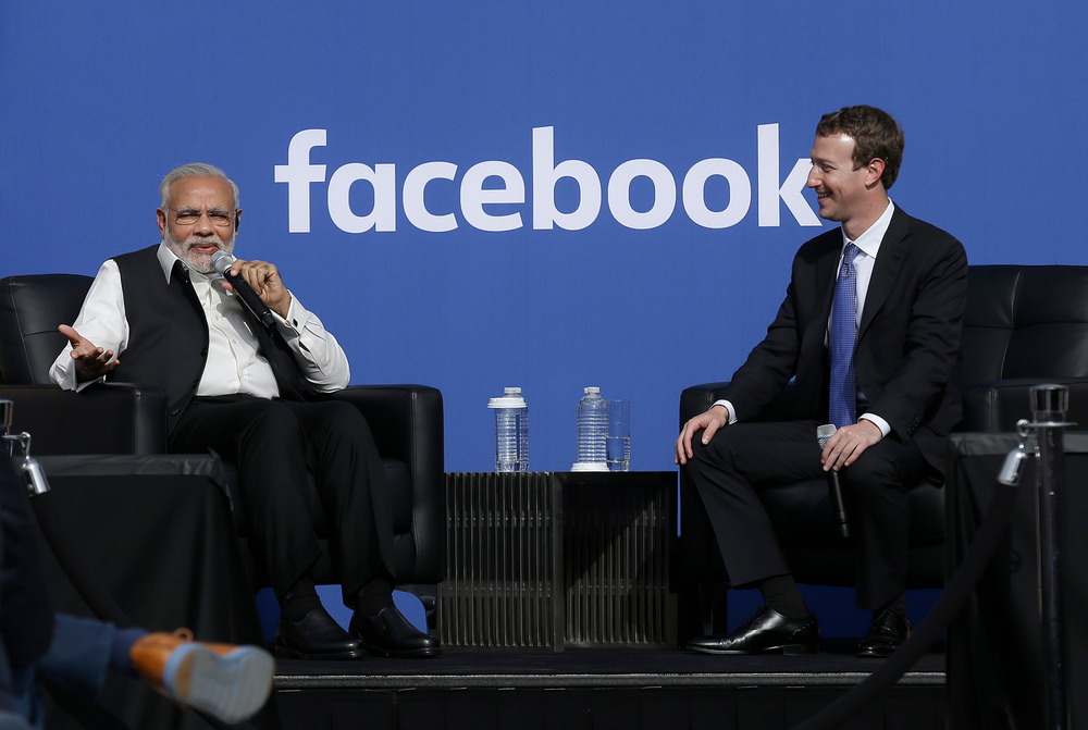 FILE - In this Sept. 27, 2015, file photo, Prime Minister of India Narendra Modi, left, speaks seated next to Facebook CEO Mark Zuckerberg at Facebook in Menlo Park, Calif. Modi, 68, the leader of the Hindu nationalist Bharatiya Janata Party, has carefully constructed an image of himself as a pious man of the people, a would-be monk called to politics who has elevated India's status globally and transformed its parliamentary elections from a contest of political parties on social and economic issues into a cult of personality. The cult has been fueled by a social media blitzkrieg. There was NaMo TV and a NaMo app. Like President Donald Trump, to whom he is often compared, Modi is a big fan of Twitter, using it and a YouTube channel managed by the BJP to bypass traditional media. (AP Photo/Jeff Chiu, File)
