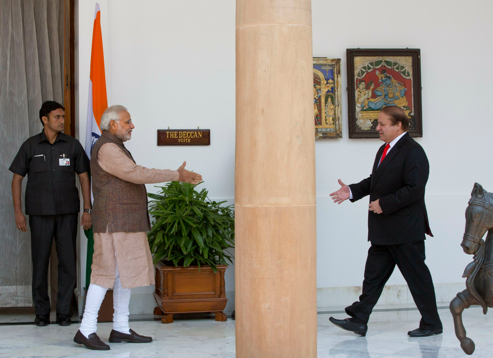 "FILE - In this May 27, 2014 file photo, Indian Prime Minister Narendra Modi, left, walks to shake hand with his Pakistani counterpart Nawaz Sharif before the start of their meeting in New Delhi, India. Indian Prime Minister Narendra Modi's party claimed it had won re-election with a commanding lead in vote count Thursday, May 23, 2019. When India retaliated after a suicide bombing in Kashmir with an airstrike of an alleged militant training camp inside Pakistan, Modi started referring to himself as India's ""chowkidar,"" or watchman, adding it as a prefix to his official Twitter account. Party leaders and a number of his 47.3 million Twitter followers quickly followed suit. (AP Photo/Manish Swarup, File)"
