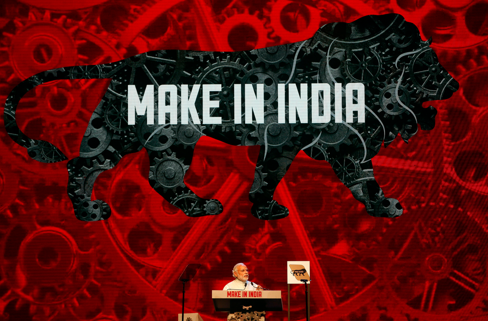 FILE - In this Feb. 13, 2016 file photo, Indian Prime Minister Narendra Modi speaks during the inaugural ceremony of 'Make in India' week, an initiative launched to encourage international companies to manufacture their goods in India, in Mumbai, India. Indian Prime Minister Narendra Modi's party claimed it had won re-election with a commanding lead in vote count Thursday, May 23, 2019. Modi, 68, the leader of the Hindu nationalist Bharatiya Janata Party, has carefully constructed an image of himself as a pious man of the people, a would-be monk called to politics who has elevated India's status globally and transformed its parliamentary elections from a contest of political parties on social and economic issues into a cult of personality. (AP Photo/Rajanish Kakade, File)