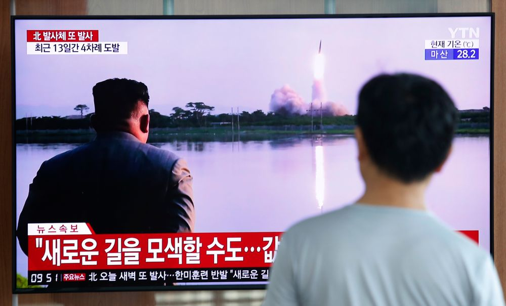 A man watches a TV showing a file image of a North Korea's missile launch during a news program at the Seoul Railway Station in Seoul, South Korea, Tuesday, Aug. 6, 2019. North Korea on Tuesday continued to ramp up its weapons demonstrations by firing unidentified projectiles twice into the sea while lashing out at the United States and South Korea for continuing their joint military exercises that the North says could derail fragile nuclear diplomacy. The sign reads