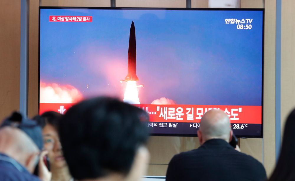 People watch a TV showing a file image of a North Korea's missile launch during a news program at the Seoul Railway Station in Seoul, South Korea, Tuesday, Aug. 6, 2019. North Korea on Tuesday continued to ramp up its weapons demonstrations by firing unidentified projectiles twice into the sea while lashing out at the United States and South Korea for continuing their joint military exercises that the North says could derail fragile nuclear diplomacy. The sign reads