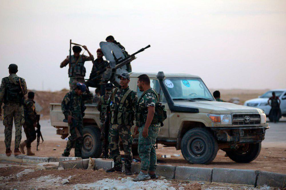 In this Monday, Oct. 14, 2019, photo, released by the Syrian official news agency SANA, Syrian troops deploy at the Tabqa airbase in Raqqa, Syria. SANA said Monday that in addition to Tabqa and its air base that carries the same name, Syrian troops entered several other villages on the southern parts of Raqqa province. (SANA via AP)