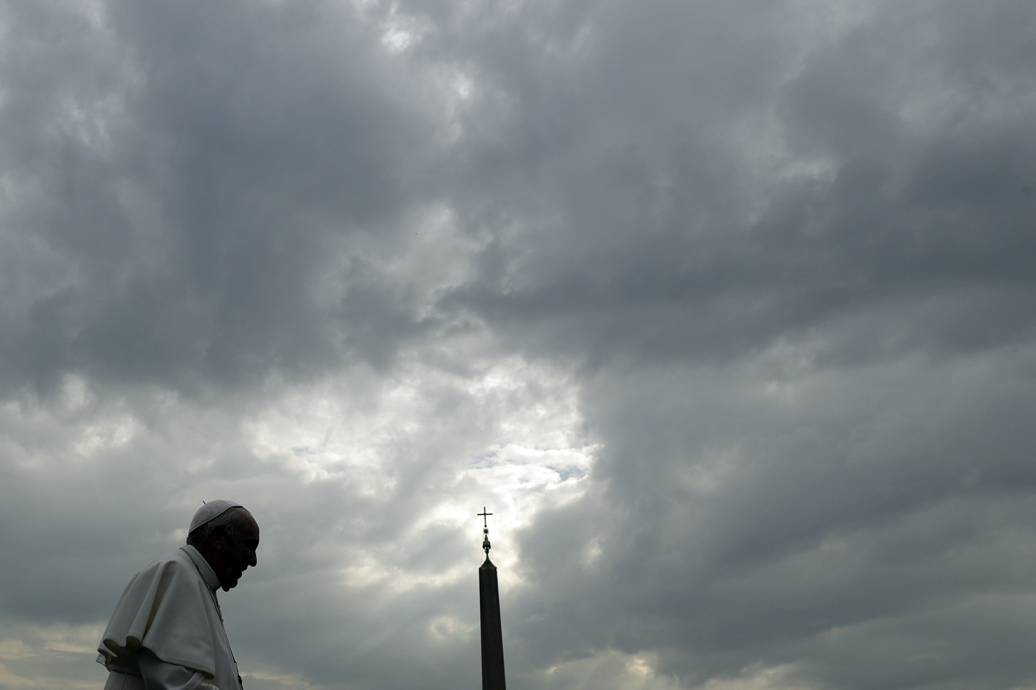 Pope Francis is silhouetted against a cloudy sky as he arrives for his weekly general audience, in St. Peter's Square, at the Vatican, Wednesday, April 3, 2019. (AP Photo/Gregorio Borgia)