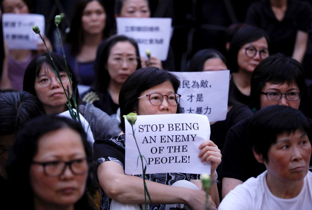 Hundreds of mothers protest against the amendments to the extradition law after Wednesday's violent protest in Hong Kong on Friday, June 14, 2019. Calm appeared to have returned to Hong Kong after days of protests by students and human rights activists opposed to a bill that would allow suspects to be tried in mainland Chinese courts. (AP Photo/Vincent Yu)