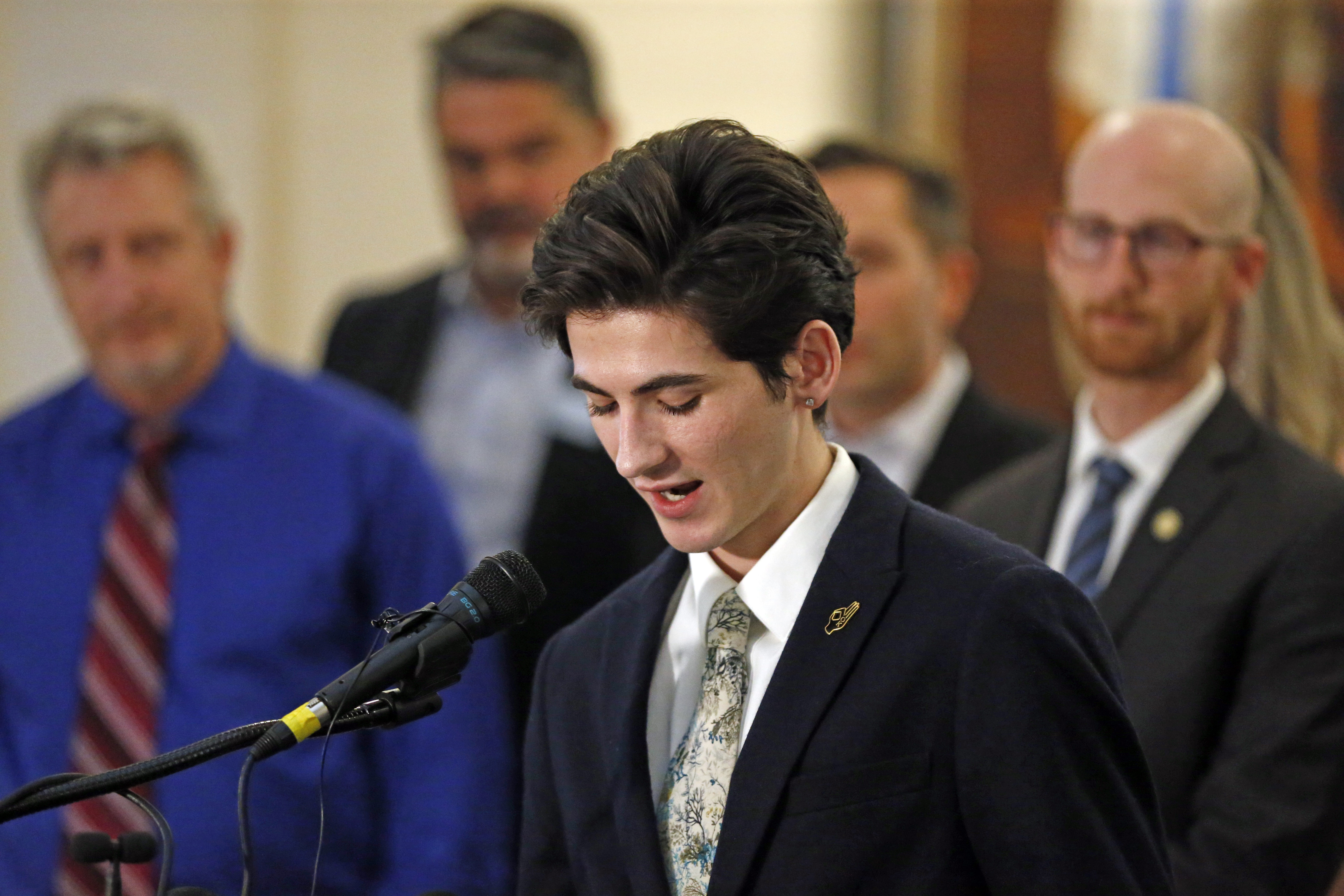 Nathan Dalley speaks during a news conference at the Utah State Capitol Thursday, Feb. 21, 2019, in Salt Lake City. Two Republican lawmakers proposed a ban on gay conversion therapy for minors in conservative Utah on Thursday, a plan that's been hailed as a milestone by advocates and won't be opposed by the influential Mormon church. Those who have been through conversion therapy, like 19-year-old Dalley, say it leaves them depressed and can lead to suicide attempts. (AP Photo/Rick Bowmer)