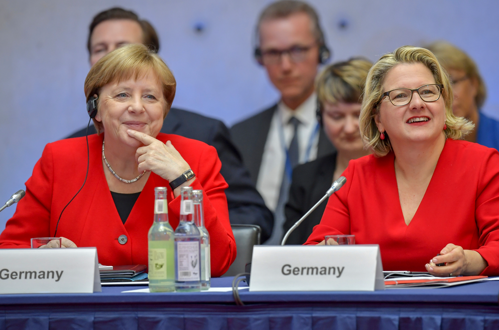 German Chancellor Angela Merkel, left, and German Environment Minister Svenja Schulze attend the 10th Petersberger Klimadialog climate conference in Berlin, Germany, Tuesday, May 14, 2019. (Tobias Schwarz/Pool via AP)