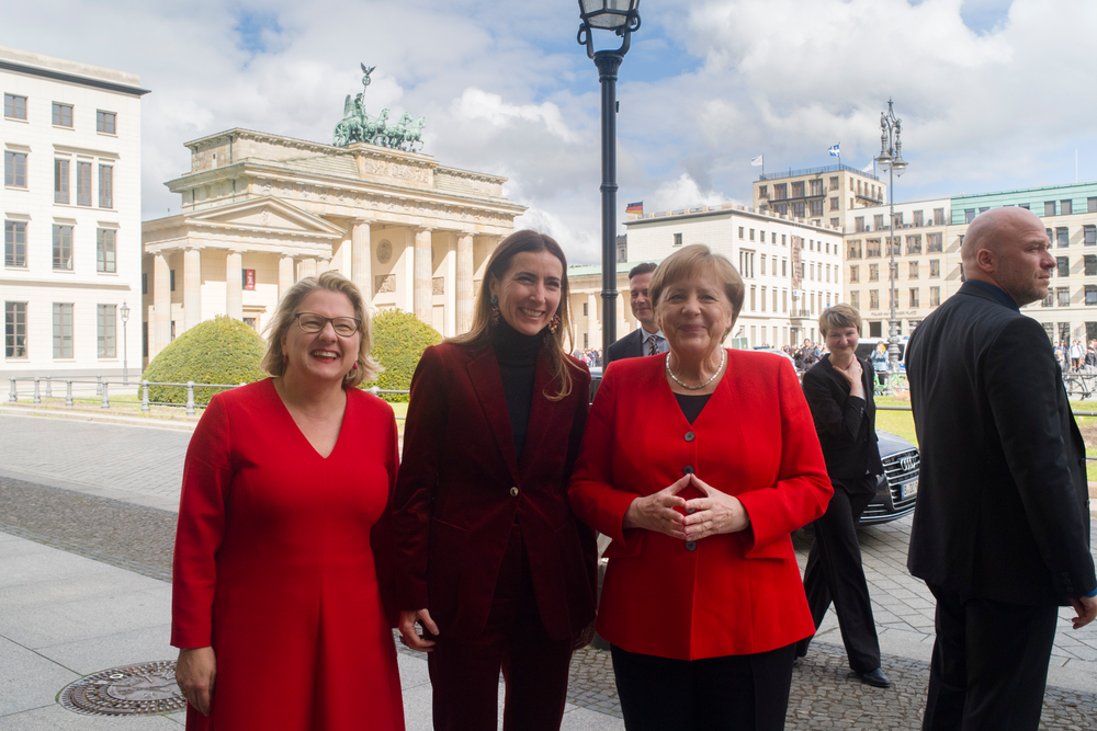 German Chancellor Angela Merkel,right, German Environment Minister Svenja Schulze, left, and Chilean Environment Minister Carolina Schmidt, center, pose for media in front of the Brandenburg Gate prior to a session of the 10th 'Petersberger Klimadialog' climate conference in Berlin, Germany, Tuesday, May 14, 2019. (AP Photo/Markus Schreiber)