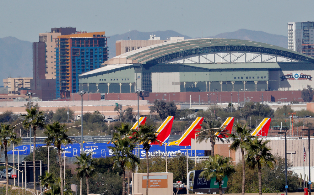 Five Boeing 737 Max jets are grounded at Sky Harbor International Airport, Thursday, March 14, 2019 in Phoenix. The U.S. issued an immediate emergency order Wednesday, grounding all 737 Max 8 and Max 9 aircraft in the wake of the crash of an Ethiopian Airliner. (AP Photo/Matt York)
