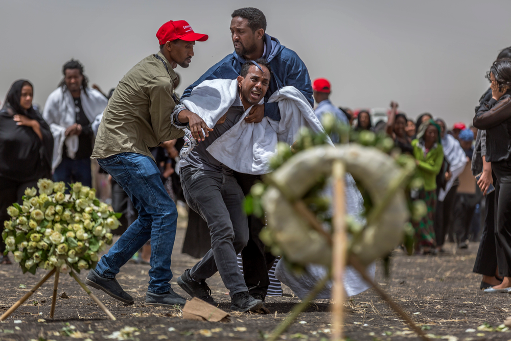 Ethiopian relatives of crash victims mourn and grieve at the scene where the Ethiopian Airlines Boeing 737 Max 8 crashed shortly after takeoff on Sunday killing all 157 on board, near Bishoftu, south-east of Addis Ababa, in Ethiopia Thursday, March 14, 2019. About 200 family members of people who died on the crashed jet stormed out of a briefing with Ethiopian Airlines officials in Addis Ababa on Thursday, complaining that the airline has not given them adequate information. (AP Photo/Mulugeta Ayene)