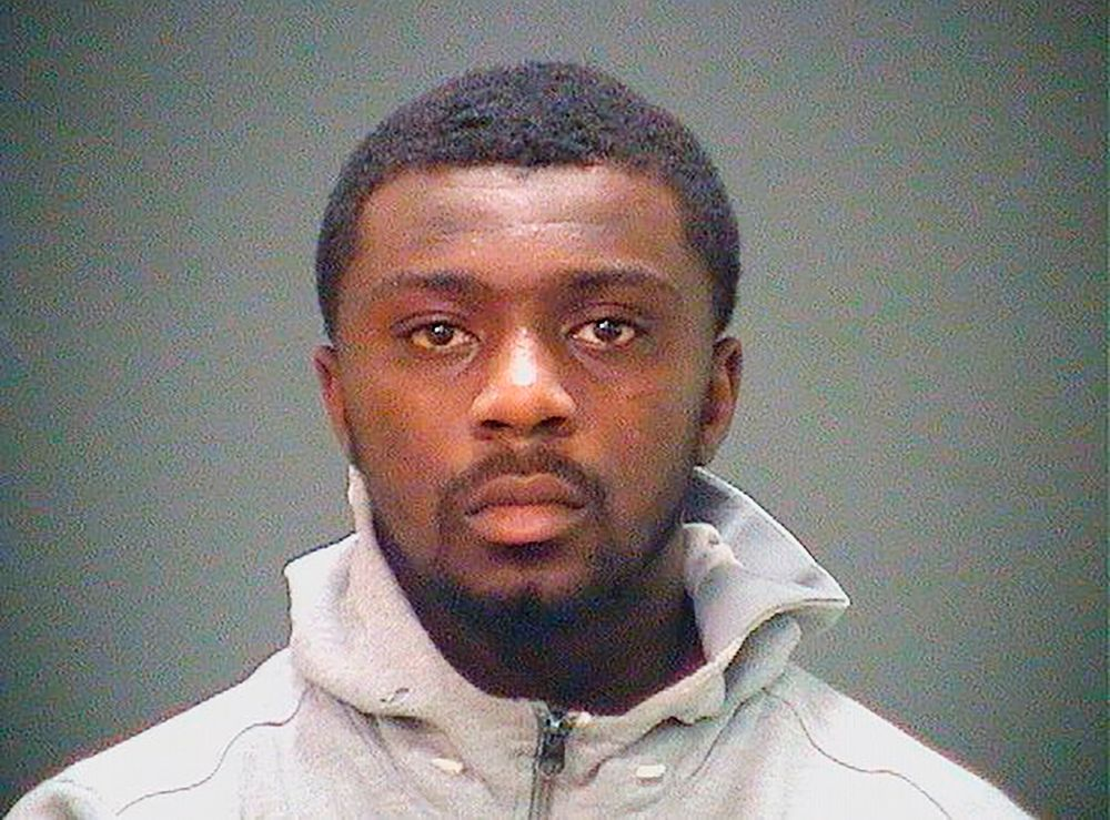 In this booking photo provided by the Cuyahoga County Sheriff's Office shows Frank Q. Jackson, a grandson of Cleveland Mayor Frank Jackson. Frank Q. Jackson has been taken into custody in an assault case after an Ohio mayor negotiated his surrender to the U.S. Marshal's Office. He was granted bond and was placed under house arrest with electronic GPS monitoring. A woman who says her son was killed by gang members connected to Frank Q. Jackson has filed a wrongful death lawsuit saying that the mayor and a police chief interfered in an investigation of the slaying. (Cuyahoga County Sheriff's Office via AP)
