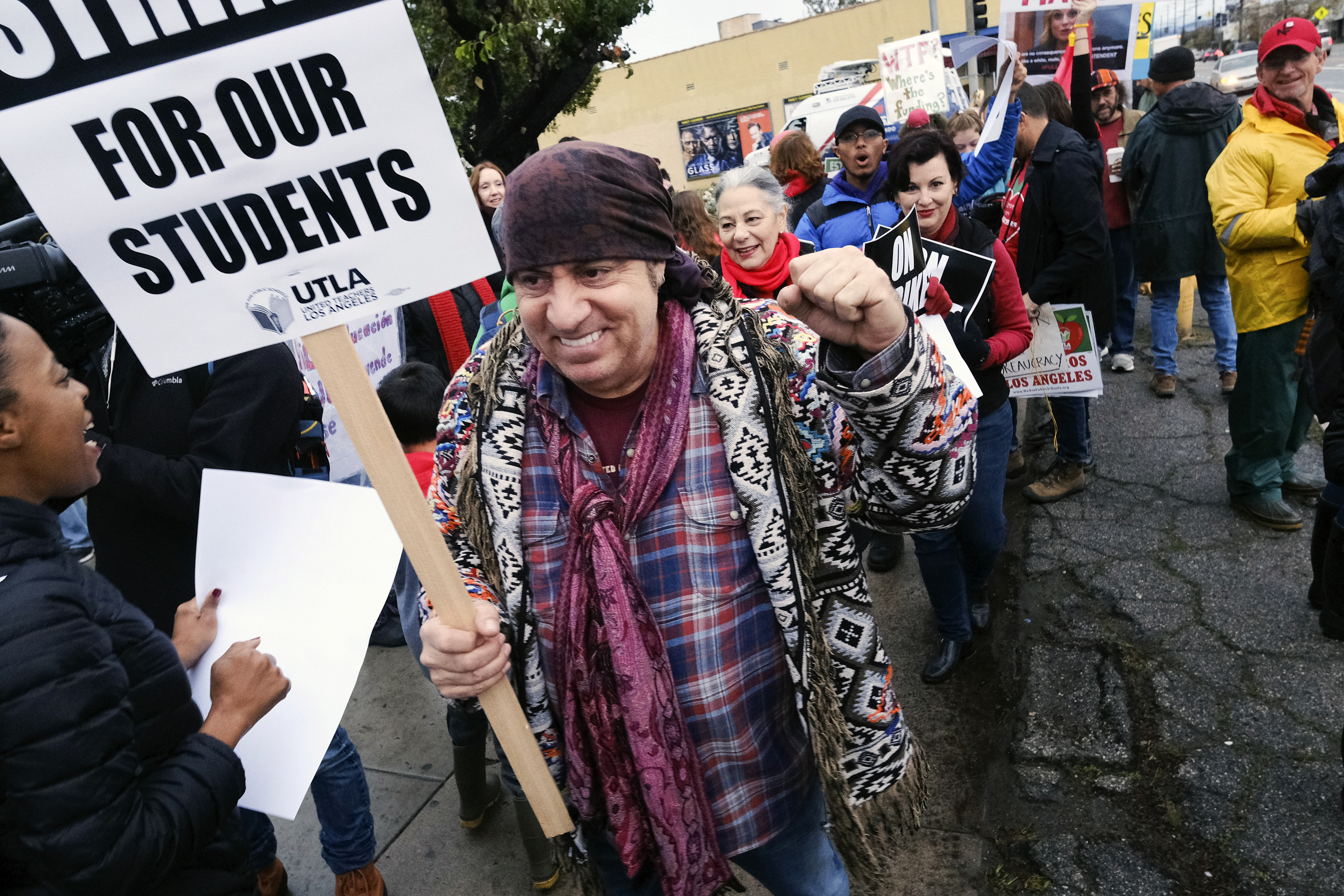 Actor, musician and activist, Steven Van Zandt supports striking teachers on the picket in front of Hamilton High School in Los Angeles on Wednesday, Jan. 16, 2019. School administrators urged the union to resume bargaining as tens of thousands of teachers planned to walk picket lines for a third day Wednesday. (AP Photo/Richard Vogel)