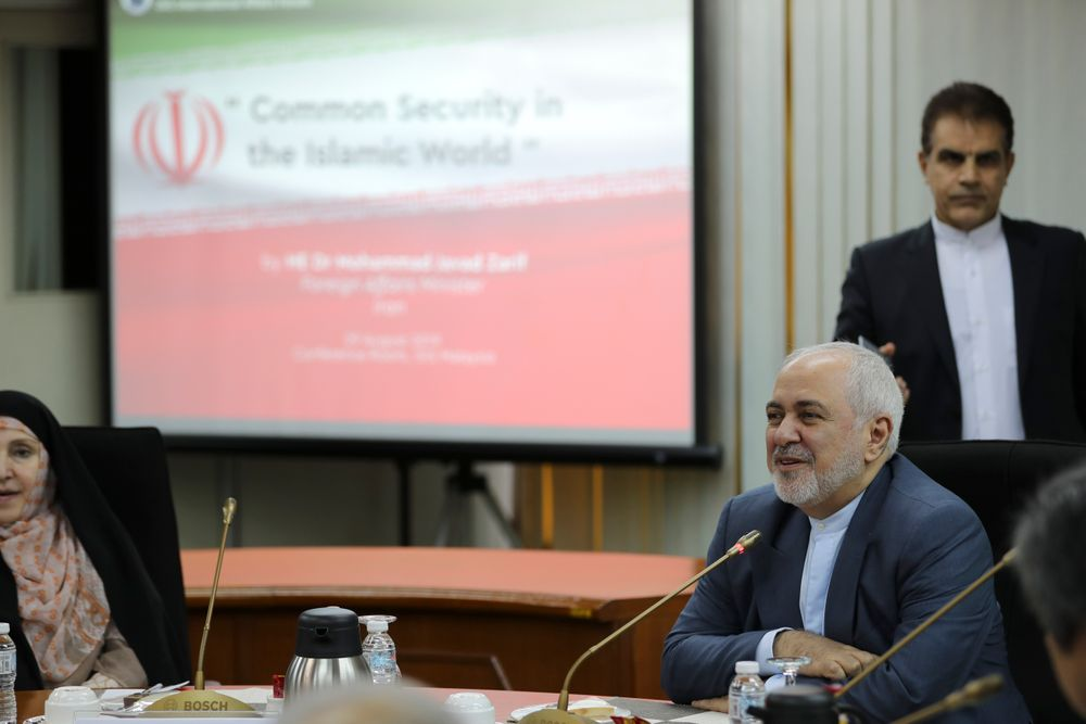 Iranian Foreign Minister Mohammad Javad Zarif, right, speaks during a forum titled