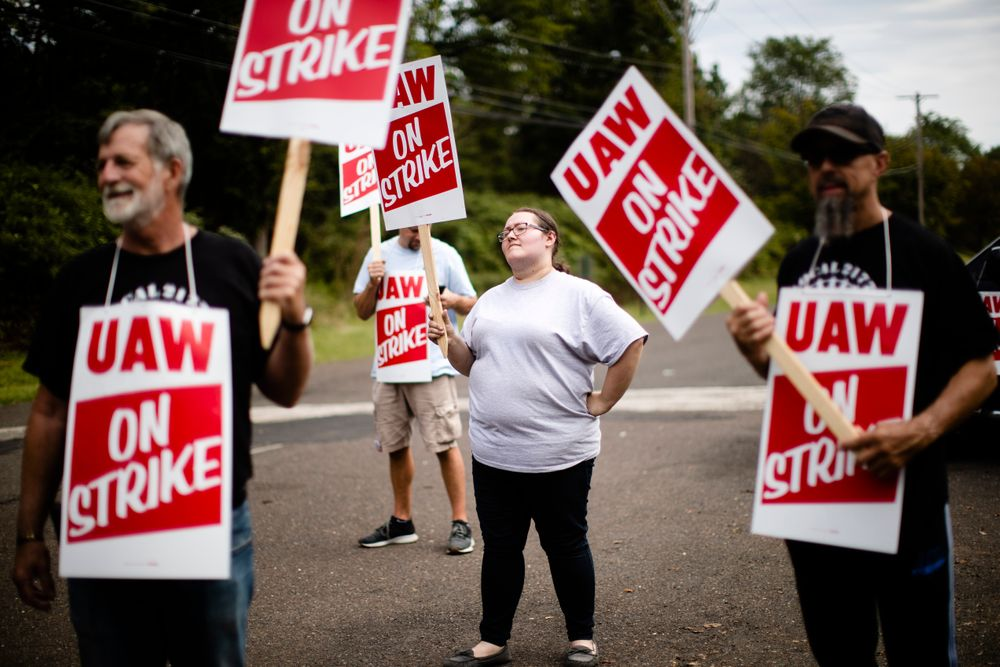 Kelly McKinnon and other workers and their supporters demonstrative outside a General Motors facility in Langhorne, Pa., Monday, Sept. 16, 2019. More than 49,000 members of the United Auto Workers walked off General Motors factory floors or set up picket lines early Monday as contract talks with the company deteriorated into a strike. (AP Photo/Matt Rourke)