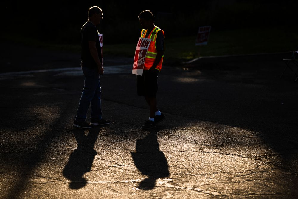 Workers Mike Jones, left, and Joel Inocencio, demonstrative outside a General Motors facility in Langhorne, Pa., Tuesday, Sept. 17, 2019. More than 49,000 members of the United Auto Workers walked off General Motors factory floors or set up picket lines early Monday as contract talks with the company deteriorated into a strike. (AP Photo/Matt Rourke)