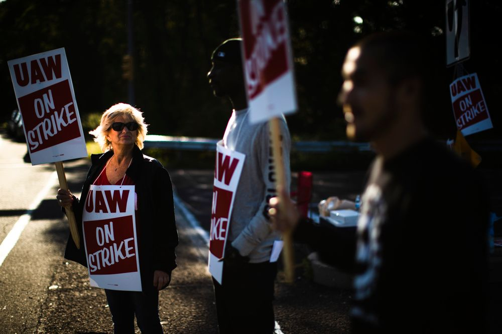 Workers demonstrative outside a General Motors facility in Langhorne, Pa., Tuesday, Sept. 17, 2019. More than 49,000 members of the United Auto Workers walked off General Motors factory floors or set up picket lines early Monday as contract talks with the company deteriorated into a strike. (AP Photo/Matt Rourke)