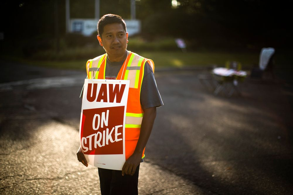 Worker Joel Inocencio demonstratives outside a General Motors facility in Langhorne, Pa., Tuesday, Sept. 17, 2019. More than 49,000 members of the United Auto Workers walked off General Motors factory floors or set up picket lines early Monday as contract talks with the company deteriorated into a strike. (AP Photo/Matt Rourke)