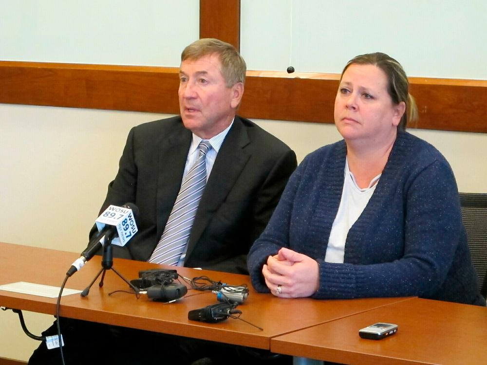 Amy Pfaff, right, and her attorney, Gerry Leeseberg, discuss the murder charges brought against William Husel, the doctor accused of deliberately ordering painkiller overdoses for Pfaff's mother and two dozen other hospital patients who died, during a news conference Wednesday, June 5, 2019, in Columbus, Ohio. (AP Photo/Kantele Franko)