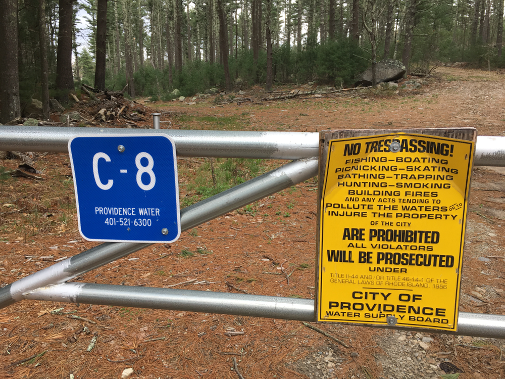 Signs marking the boundary of the property owned by Providence Water.