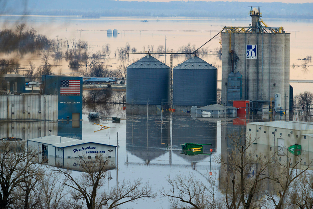CORRECTS TO MARCH FROM MAY - Floodwaters surround buildings on the southwest side of Hamburg, Iowa, Sunday, March 17, 2019. Residents in parts of southwestern Iowa were forced out of their homes Sunday as a torrent of Missouri River water flowed over and through levees, putting them in a situation similar to hundreds of people in neighboring Nebraska who have been displaced by the late-winter flood. (Ryan Soderlin/Omaha World-Herald via AP)