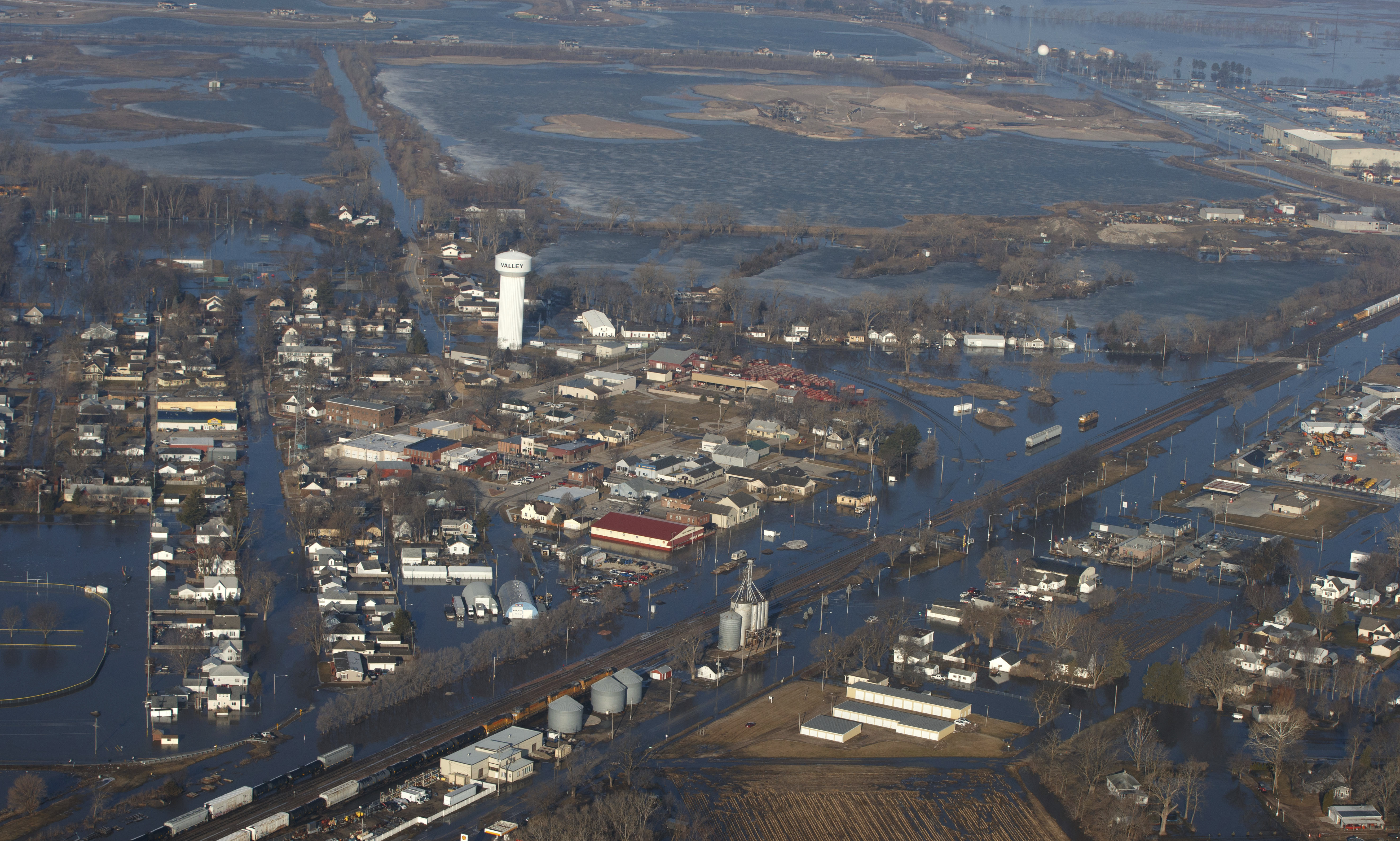 CORRECTS MONTH TO MARCH NOT MAY - The city of Valley is inundated with floodwaters Sunday, March 17, 2019, in Valley, Neb. Hundreds of people were evacuated from their homes in Nebraska and Iowa as levees succumbed to the rush of water.  (Jeff Bundy/Omaha World-Herald via AP)