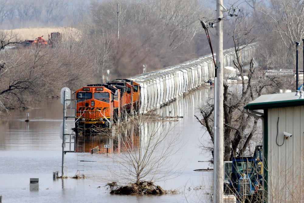 A BNSF train sits in flood waters from the Platte River, in Plattsmouth, Neb., Sunday, March 17, 2019. Hundreds of people remained out of their homes in Nebraska, but rivers there were starting to recede. The National Weather Service said the Elkhorn River remained at major flood stage but was dropping. (AP Photo/Nati Harnik)