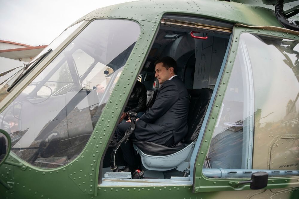In this handout photo provided by the Ukrainian Presidential Press Office ,Ukrainian President Volodymyr Zelenskiy sits inside a military helicopter as he visits an arm exhibition in Kyiv, Ukraine, Wednesday, Oct. 9, 2019. (Ukrainian Presidential Press Office via AP)