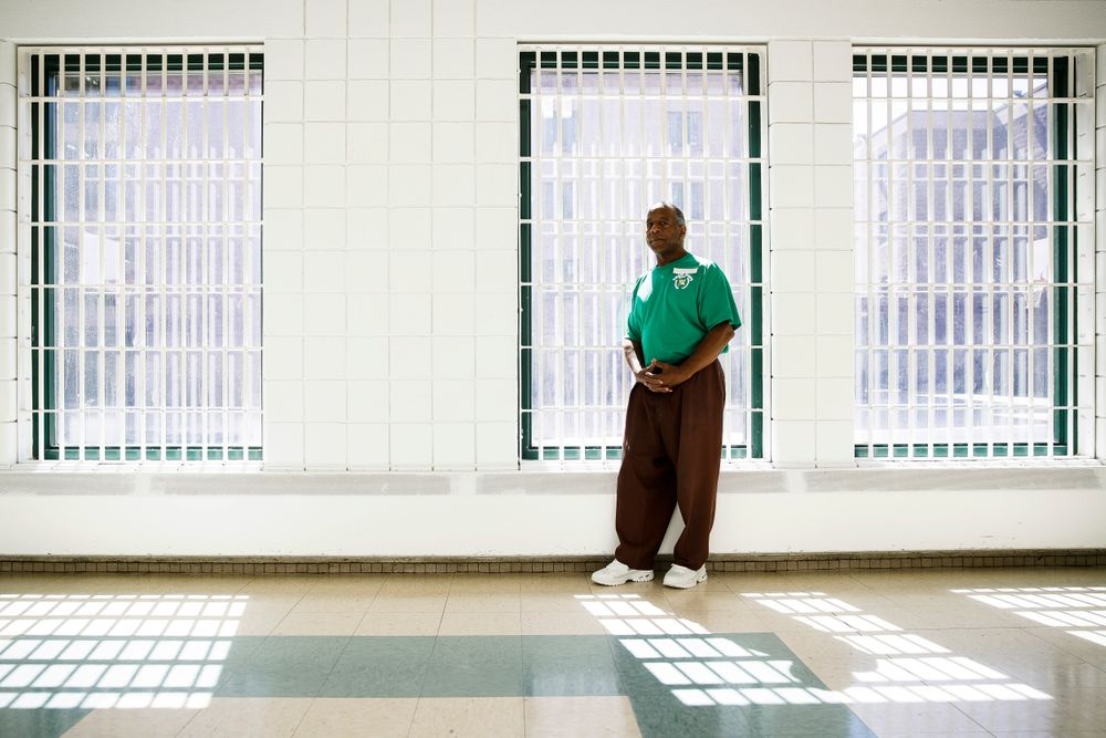 """In this Thursday, Aug. 29, 2019 photo incarcerated filmmaker Ezra poses for a portrait at the State Correctional Institution in Chester, Pa.  Eastern State Penitentiary, a former prison that's now a museum in Philadelphia is showcasing the work of currently incarcerated filmmakers, projecting the animated shorts onto its outside walls. The new exhibit titled """"Hidden Lives Illuminated"""" offers a glimpse into the lives of these inmates to passersby and museum visitors alike.  (AP Photo/Matt Rourke)"""