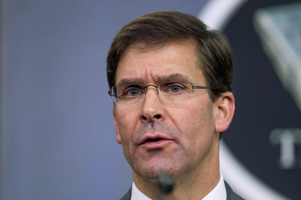 FILE - In this Aug. 28, 2019, file photo, Secretary of Defense Mark Esper speaks to reporters during a briefing at the Pentagon. Esper says the