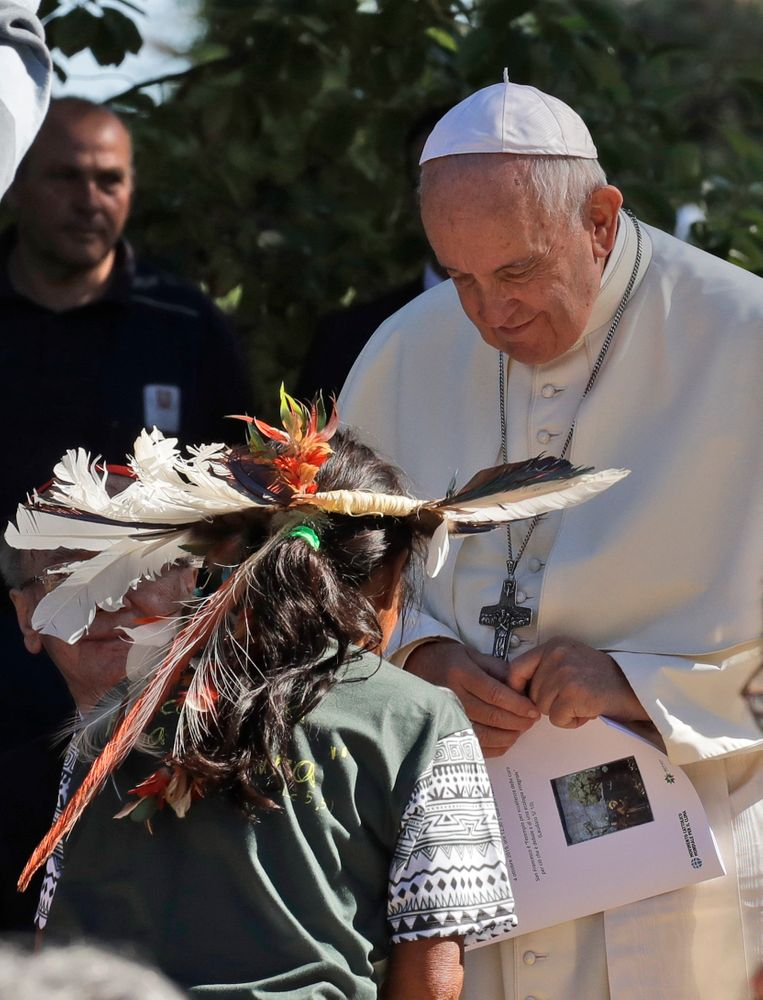Pope Francis meets members of indigenous populations on the occasion of the feast of St. Francis of Assisi, the patron saint of ecology, at the Vatican, Friday, Oct. 4, 2019. The ceremony takes place two days before a Synod of bishops on the Pan-Amazon region opens at the Vatican to address the ecological, social and spiritual needs of indigenous peoples in the Amazon. (AP Photo/Alessandra Tarantino)