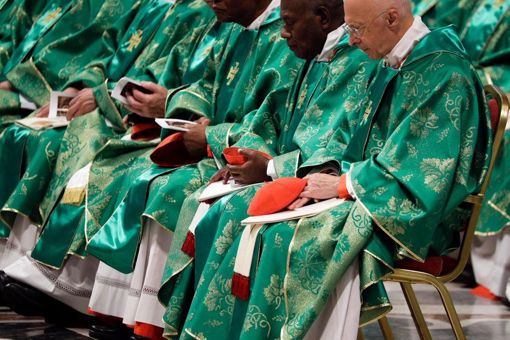 Prelates wear green vestments as they attend an opening Mass for the Amazon synod, in St. Peter's Basilica, at the Vatican, Sunday, Oct. 6, 2019. Francis celebrated an opening Mass in St. Peter's Basilica with global attention newly focused on the forest fires that are devouring the rainforest, which scientists say is a crucial bulwark against global warming. On hand for the service were indigenous peoples, some with their faces painted and wearing feathered headdresses, as well as more than 180 South American cardinals, bishops and priests, who donned green vestments like the pope. (AP Photo/Andrew Medichini)