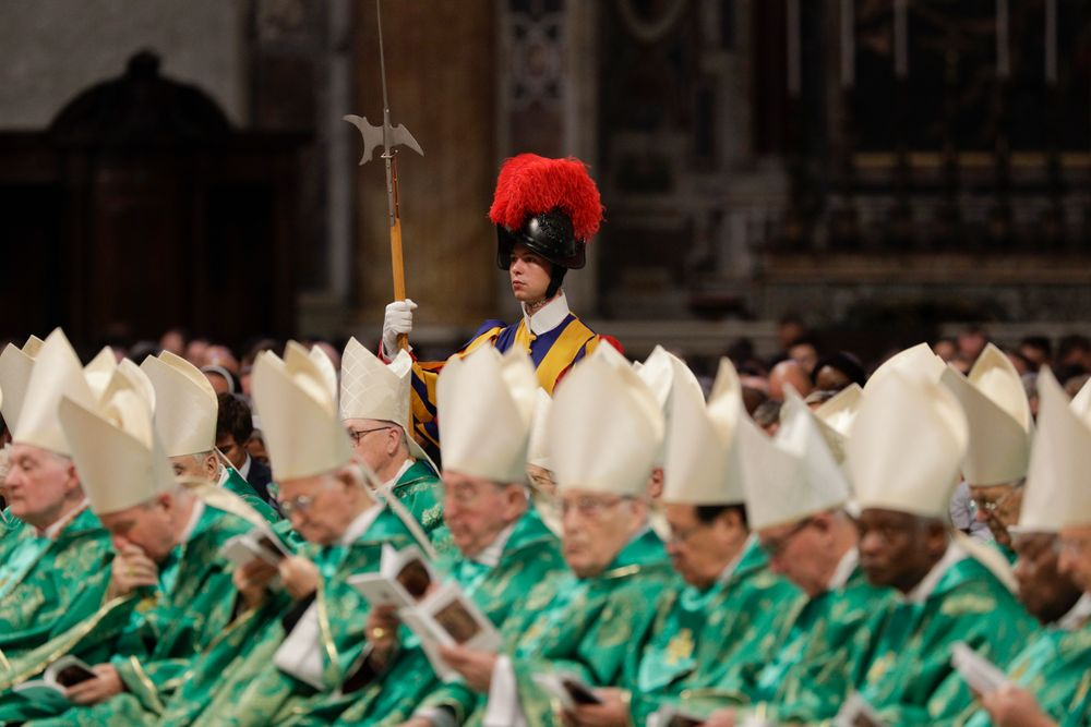 A Swiss guard stands attention as Pope Francis celebrates an opening Mass for the Amazon synod, in St. Peter's Basilica, at the Vatican, Sunday, Oct. 6, 2019. Pope Francis is opening a divisive meeting on preserving the Amazon and ministering to its indigenous peoples, as he fends off attacks from conservatives who are opposed to his ecological agenda.(AP Photo/Andrew Medichini)
