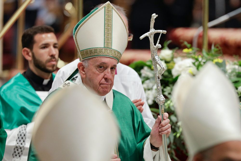 Pope Francis leaves after celebrating an opening Mass for the Amazon synod, in St. Peter's Basilica, at the Vatican, Sunday, Oct. 6, 2019. Pope Francis urged bishops on Sunday to boldly shake up the status quo as they chart ways to better care for the Amazon and its indigenous peoples, amid threats from forest fires, development and what he called ideological