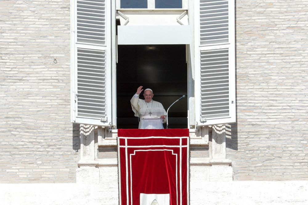 Pope Francis delivers his blessing during the Angelus noon prayer he recited from the window of his studio overlooking St. Peter's Square, at the Vatican, Sunday, Oct. 6, 2019. The pontiff earlier in the morning celebrated in St. Peter's Basilica an opening Mass for the Amazon synod. (AP Photo/Andrew Medichini)