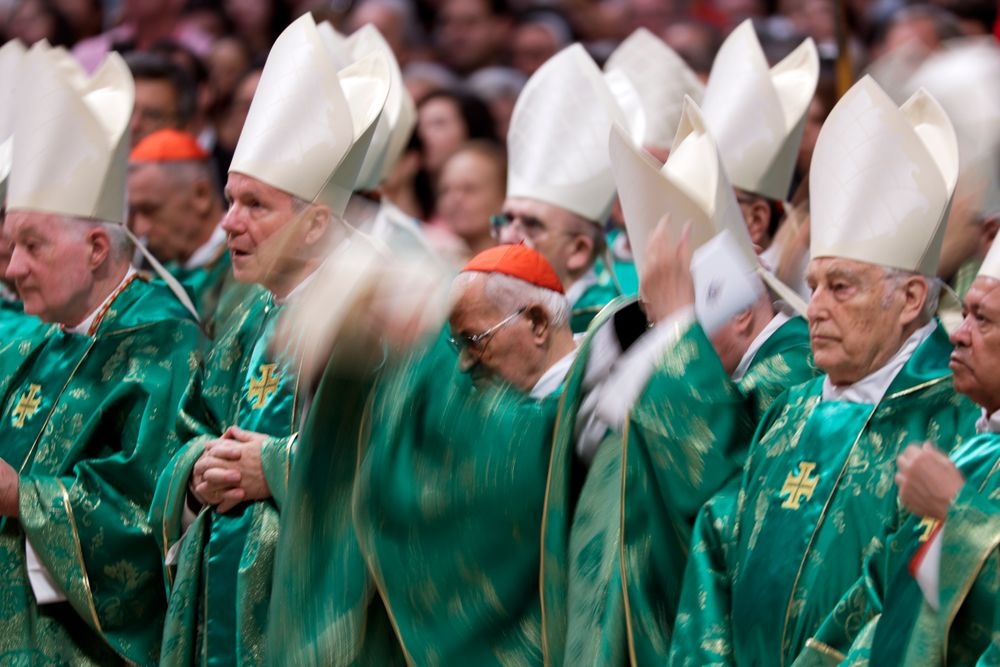 Prelates wear green vestments as they attend an opening Mass for the Amazon synod celebrated by Pope Francis, in St. Peter's Basilica, at the Vatican, Sunday, Oct. 6, 2019. Pope Francis urged bishops on Sunday to boldly shake up the status quo as they chart ways to better care for the Amazon and its indigenous peoples, amid threats from forest fires, development and what he called ideological