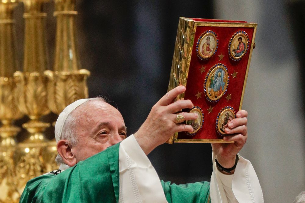 Pope Francis holds up the book of Gospels celebrates an opening Mass for the Amazon synod, in St. Peter's Basilica, at the Vatican, Sunday, Oct. 6, 2019. Pope Francis is opening a divisive meeting on preserving the Amazon and ministering to its indigenous peoples, as he fends off attacks from conservatives who are opposed to his ecological agenda. (AP Photo/Andrew Medichini)