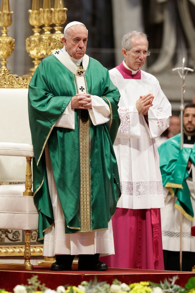 Pope Francis is flanked by Mons. Guido Marini, the Vatican master of liturgical ceremonies, as he celebrates an opening Mass for the Amazon synod, in St. Peter's Basilica, at the Vatican, Sunday, Oct. 6, 2019. Pope Francis is opening a divisive meeting on preserving the Amazon and ministering to its indigenous peoples, as he fends off attacks from conservatives who are opposed to his ecological agenda. (AP Photo/Andrew Medichini)
