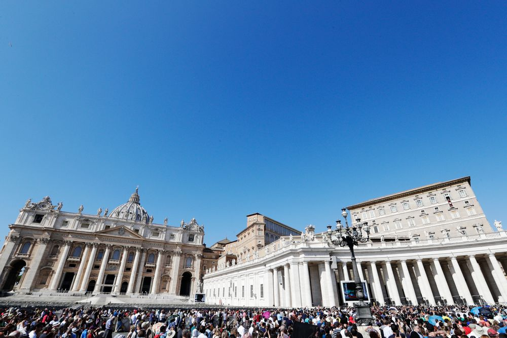 Pope Francis, top right, delivers his blessing during the Angelus noon prayer he recited from the window of his studio overlooking St. Peter's Square, at the Vatican, Sunday, Oct. 6, 2019. The pontiff earlier in the morning celebrated in St. Peter's Basilica an opening Mass for the Amazon synod. (AP Photo/Andrew Medichini)