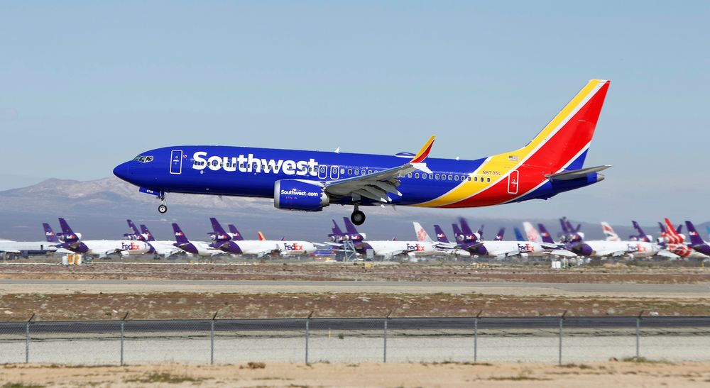 FILE - In this March 23, 2019, file photo, a Southwest Airlines Boeing 737 Max aircraft lands at the Southern California Logistics Airport in the high desert town of Victorville, Calif. A lawsuit filed against Southwest Airlines by a flight attendant alleges pilots on a 2017 flight had an iPad streaming video from a hidden camera in a bathroom in one of the airline's jets. Court filings by attorneys for Dallas-based Southwest and the two pilots denied the livestreaming allegations, and Southwest issued a brief statement Saturday, Oct. 26, saying it would not comment in detail on the suit but denied placing cameras in the lavatories in aircraft. (AP Photo/Matt Hartman, File)