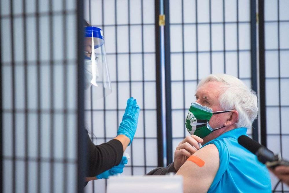 Paul Higgins, 67, of Warwick, gets a COVID-19 vaccine at Clinica Esperanza in Providence, R.I.