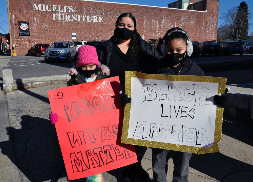 Cookie River (center) and her two nieces are pictured at a Black Lives Matter demonstration on Sunday, Jan. 11, 2021, in downtown Westerly.