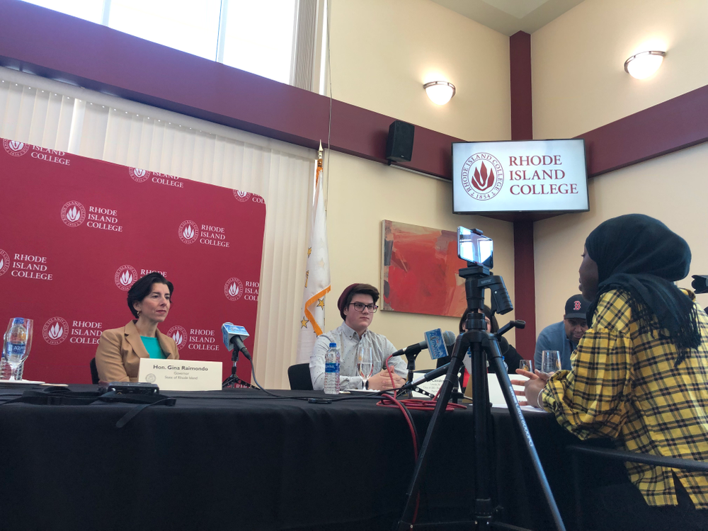 Gov. Gina Raimondo listens to a student during a discussion at Rhode Island College. The governor is pushing for an expansion of a program that pays college students' tuition.