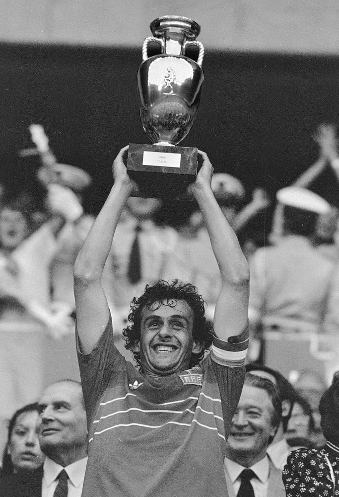 "FILE - In this file b/w photo dated June 27, 1984 French team captain Michel Platini holds high the winner's cup after France beat Spain, 2-0, in the final match of the European Soccer Championship at the Parc des Princes stadium in Paris.  Affectionately nicknamed ""Le Roi"" (The King), Michel Platini bestrode the soccer field with inimitable elegance as the world's best player of the early 1980s, but his lofty reputation seems to have been tainted.(AP Photo, FILE)"